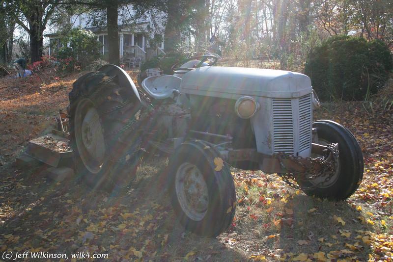 #2804 Old tractor in a fan of sunbeams