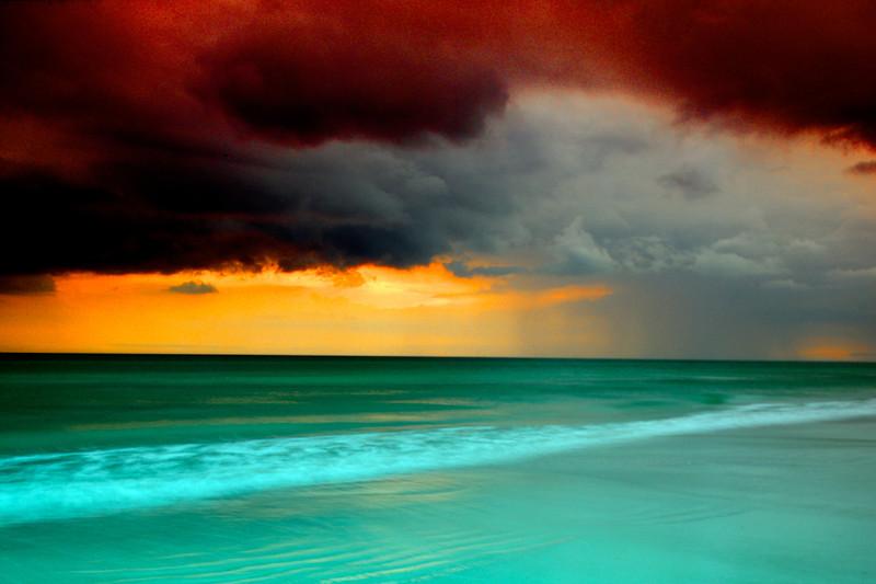 Storm coming ashore at sunset along the gulf coast at Siesta Key, Sarasota, Florida