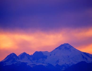 Cloudy, Colorful Sunset, Mount Illiamna, Alaska