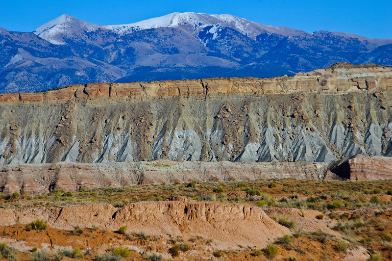 Nobody, North America, USA, Utah, Capitol Reef National Park, Views Along Notom Road of Waterpocket Fold, Formations of Sandstone and the Snow-capped Henry Mountains