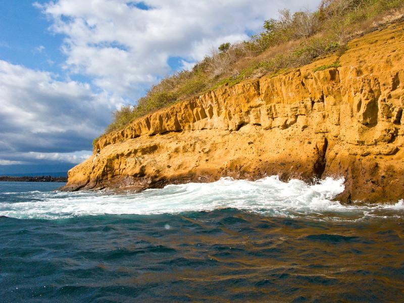 South America, Ecuador, Galapagos Islands, eroded Bartolome  Island coast and surf
