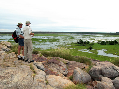 Australia, No. Territory, Kakadu National Park, UNESCO World Heritage Site, Ubirr Aboriginal Rock Art Site, Tourists viewing Nardab Floodplain from top of Rock