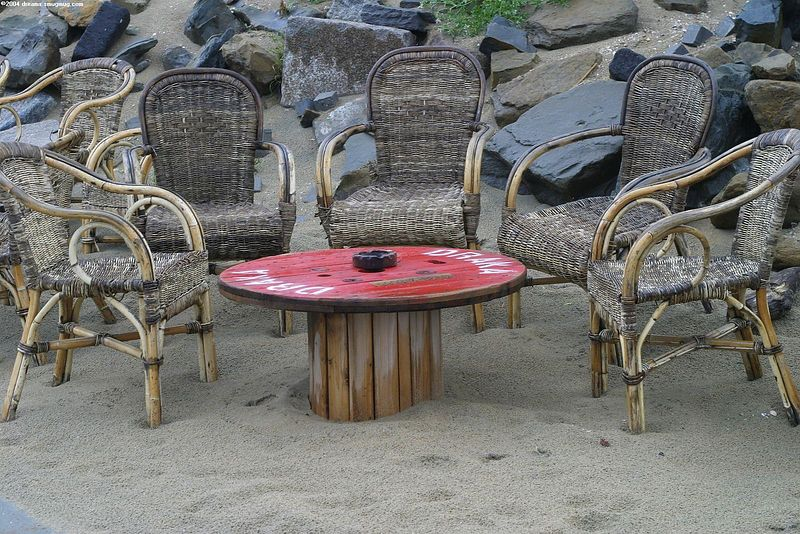 "Chairs in front of <a href=""http://www.meccastrandpaviljoen.nl/"">strandtent Mecca</a>"