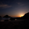 A lone fisherman goes for his last catch on the beach at Big Sur as the sun sets.