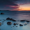 Northport, Leelanau township, MI<br /> Sleepy Rocks: soft waves caress a cluster of rocks, as light fades over the shallows that crest Leelanau peninsula.