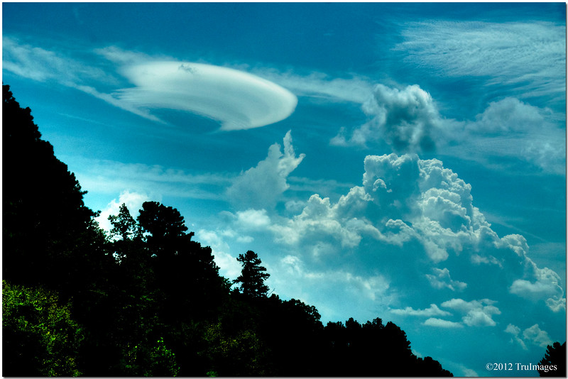 "Sept 12 <br /> ""They're here!"" (Poltergeist, 1982)<br /> <br /> As I was driving home, I couldnt help but notice this cloud in the sky. it looks like a UFO with a contrail entering our atmosphere! Are visitors from Planet X here already???"