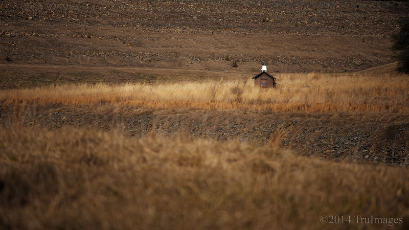 Feb 12<br /> Loneliness <br /> <br /> A small shed stands alone in the distance.