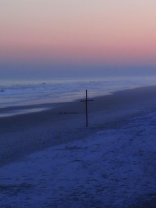 A cross for Easter on the beach in North Carolina photographed near sunset the day after Easter 2013.