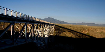 The Rio Grande Gorge Bridge and its own shadow a few miles north of Taos.