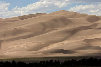 The Great Sand Dunes NP, Colorado.  Changes every moment as the wind blows and sculpts the sand into endless waves and designs.  The slowly setting sun also makes every capture different from one of just moments earlier.  The tiny dots in the upper right are not dust spots on the sensor, they are the VERY intrepid people who have CLIMBED TO THE TOP in the wind, altitude and soft, shifting sand.
