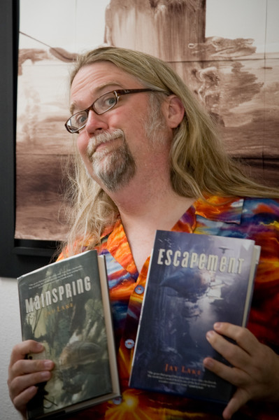 Jay Lake with a couple of his books.