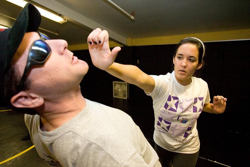 Senior Erin Ponto demonstrates a palm punch.