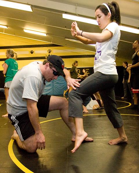 Senior Erin Ponto demonstrates kneeing an attacker.