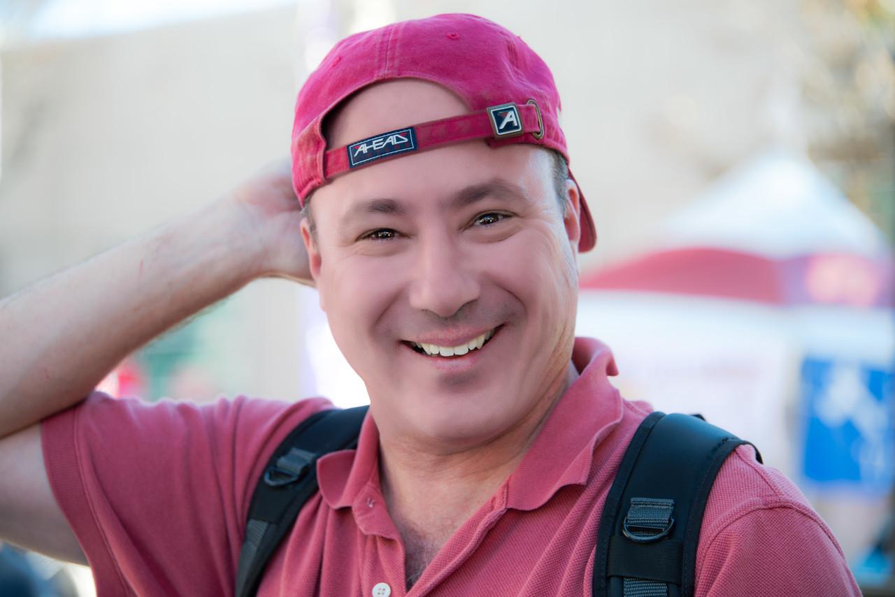me with ball cap backwards at a photo shoot
