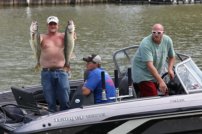 Randy Cline holds up the day's walleye catch after fishing with Jimmy and Rob Cline in Vermilion on Labor Day. RAY RIEDEL/CHRONICLE