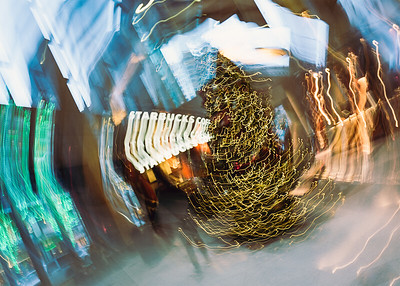 Glass artwork on display at City Centre, Seattle, WA. Intentional camera motion used with a slow shutter.