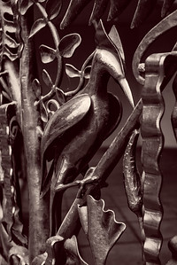 A closeup of a large intricately designed metal gate with a bird for the  King Street Center Building, Seattle.
