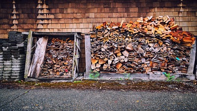 Firewood piled behind a home in an alleyway in West Seattle.
