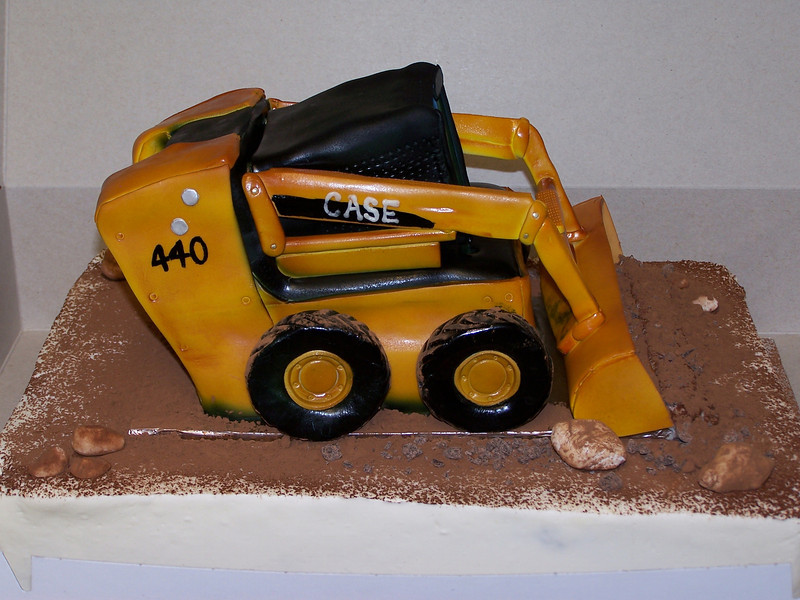 "Skid Steer Birthday Cake made by Baked by Design,  <a href=""http://www.reddoorbakery.com"">http://www.reddoorbakery.com</a>.<br /> <br /> When you turn 40 aren't you about due to enjoy a fun cake in the shape of your favorite toy just like when you were a kid?"