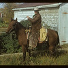 Doc Dixon [on horse back] drove cattle in. Mankota. 10/01/1954