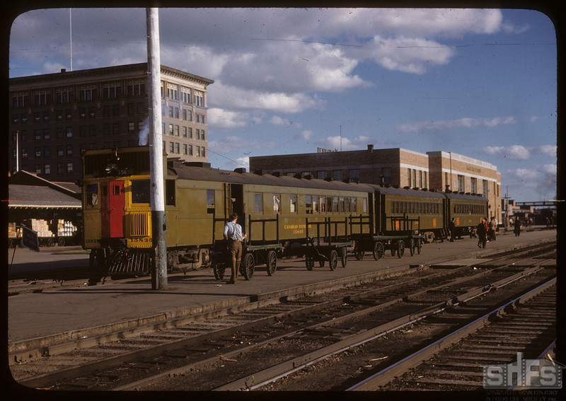 Train taking students to Co-op School in Prince Albert [CNR station]. Saskatoon. 07/10/1946.