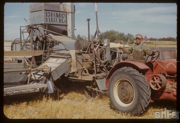 """Elmer Warner's """"One man gang"""" [1907 Cockshuck tractor]. Orkney. 08/21/1951"""