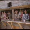 Livestock booth. [Nora Gillespie in dark green top]. Mankota.  08/23/1958