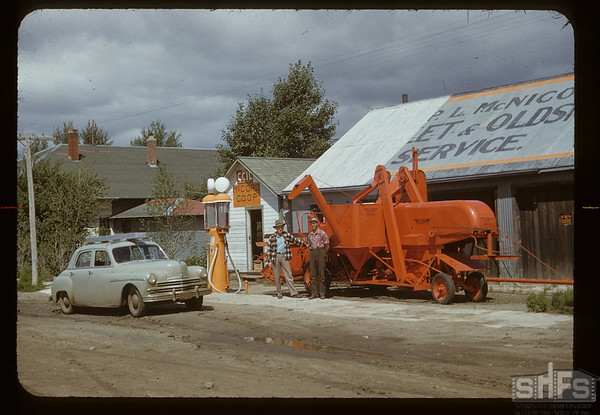 McCord Co-op - McLeod & Don McTaggart [with new Co-op combine]. McCord.	 08/11/1950