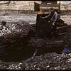 W. H. Wilkins loading lignite coal at his mine. Shaunavon. 06/18/1947