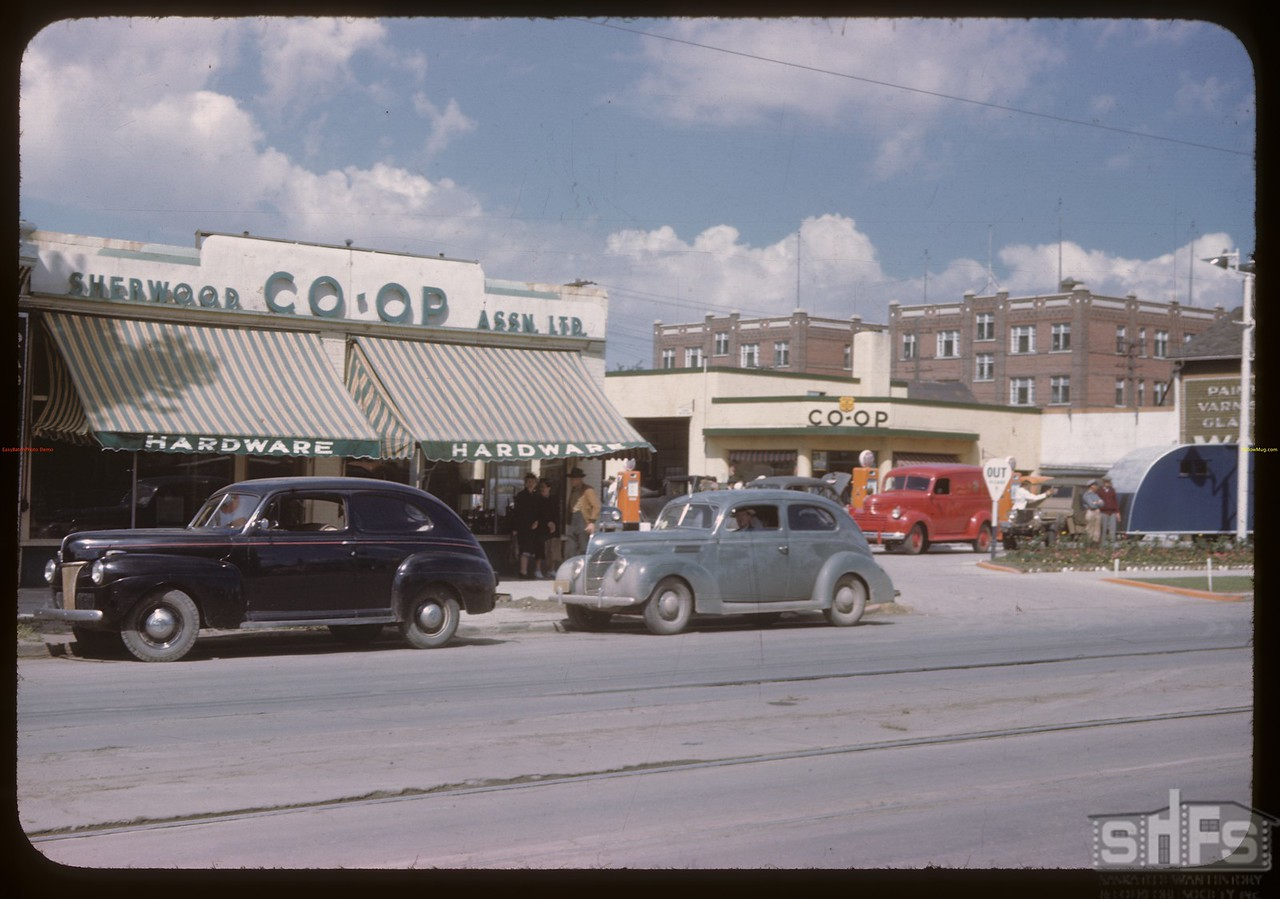 Sherwood Co-op hardware and garage [cars are 1946 & 1937 Fords; apartment building in background is still standing - Huntington] Regina 08/10/1946