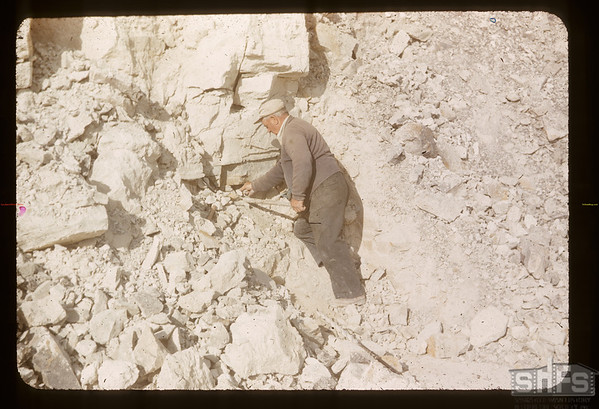 Al Vogt placing dynamit to blast white mud. Eastend. 05/15/1956