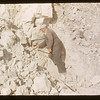 Al Vogt placing dynamit to blast white mud. Eastend. 05/15/1956