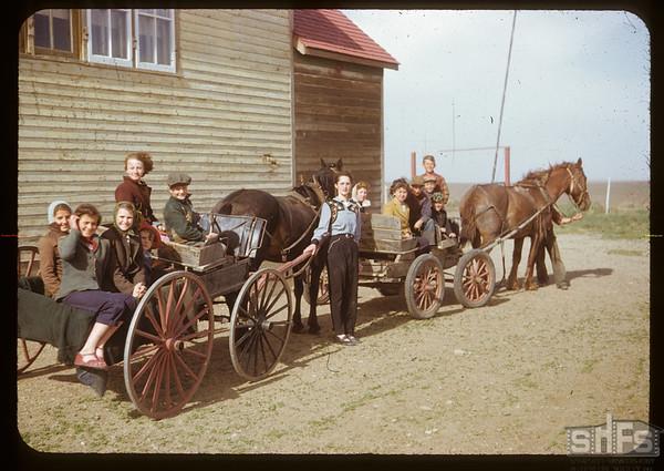 Notique school - Alice Cyrenne teacher [vehicle in front is Bennet Buggy]. Gouveneur. 05/25/1951