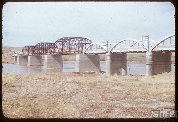 2nd new bridge under construction.  Note that the bridge has been raised 10 feet from its original construction.  This new bridge was officially opened on July 9, 1953.  Sask. Landing 05/04/1953