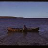 Chief Petkukuk and birch bark canoe.  Loon Lake. 10/29/1943