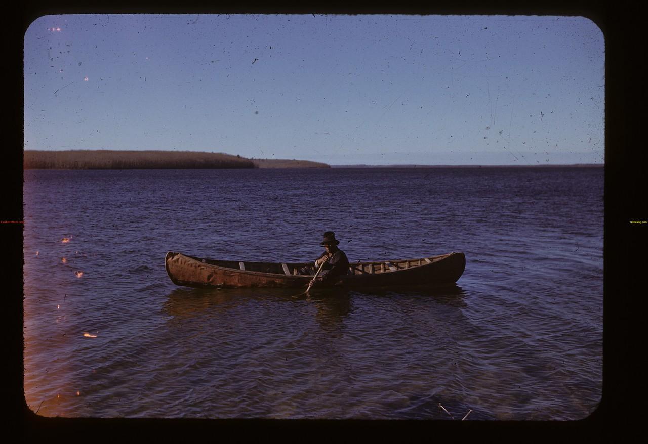 Chief Petkukuk and birch bark canoe.  Loon Lake. 10/29/1943