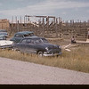 Jack Dunn - building stockyards. [Jack sitting down]. Mankota. 07/30/1957