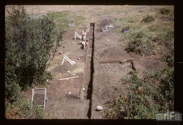 Gull Lake archaeologist's dig - Tom & Alice Kehoe.  Gull Lake. 07/16/1960