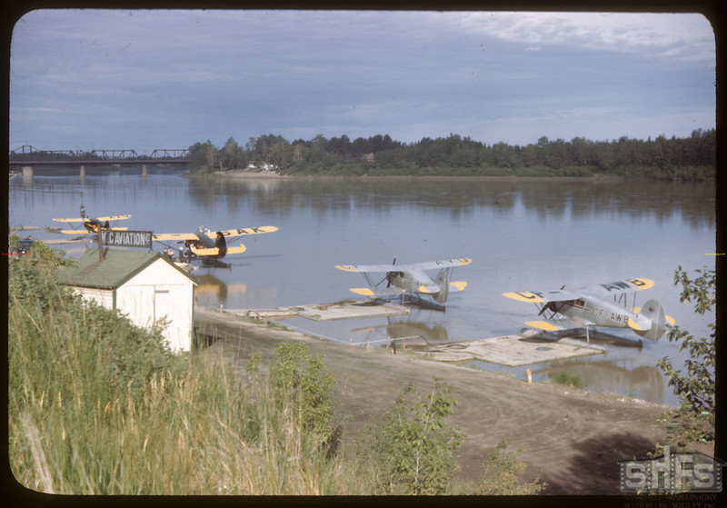 Pontoon planes lined up on North Sask. River. Prince Albert 06/21/1946
