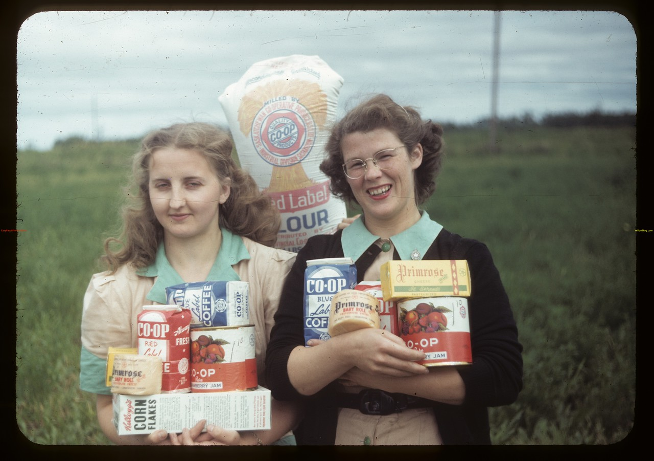 Co-op store girls hold some of the products that are for sale. White Fox. 07/19/1949