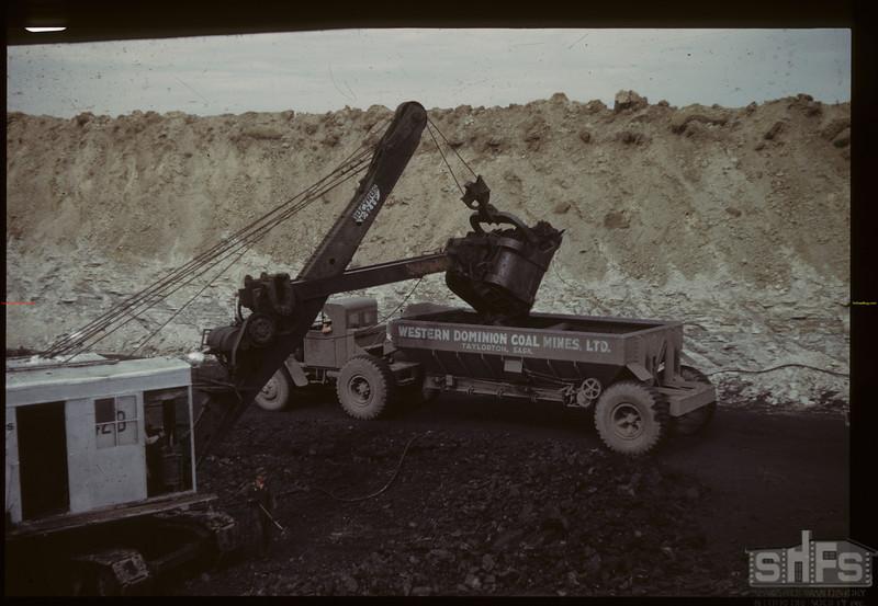 Coal stripper loading diesel truck - Western Dominion Mines Ltd. Bienfait. 09/10/1942