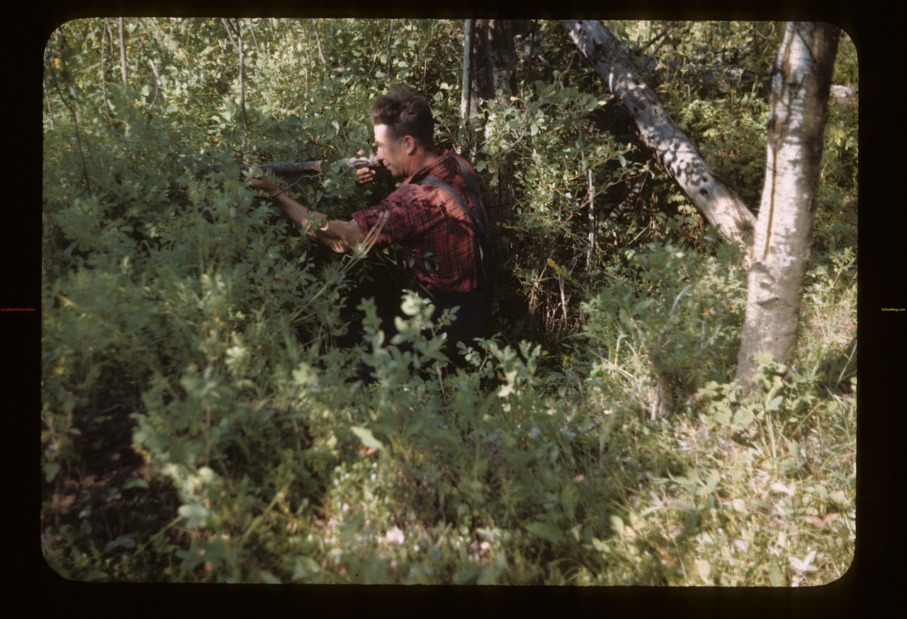 Hugh Brown in Indian rifle pits. Frenchman Butte. 08/15/1945