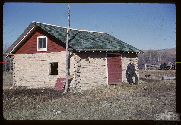 Pete Laflambois and log barn he made. Maple Creek. 10/27/1962