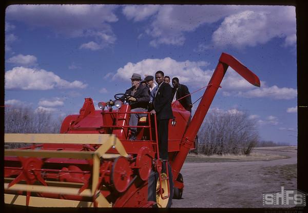International Students at George Hopkins Farm [on combine]. Bratton. 04/01/1963