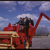 International Students at George Hopkins Farm [on combine]. Bratton. 04/01/1963