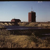 CPR dam and water tower. Ball on post of tower moves up & down and indicates the water level within the tower.  The reservoir was a popular swimming hole. Consul. 06/06/1949