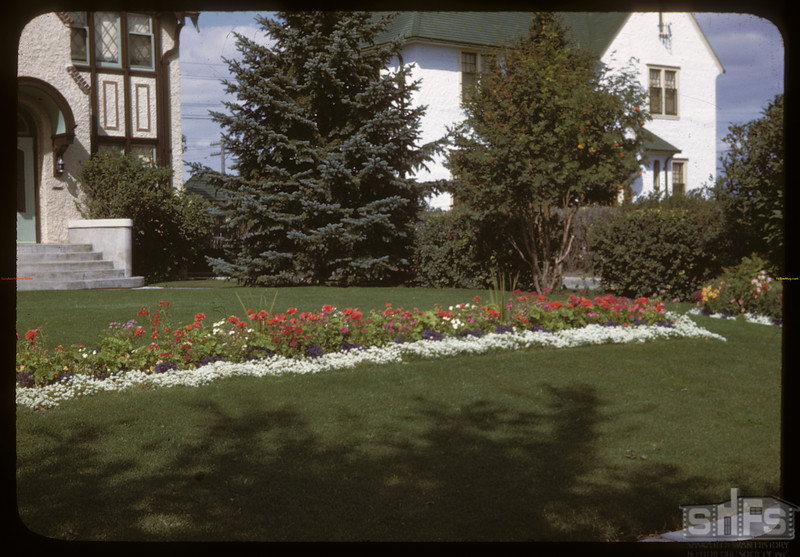 Lawn and flowers for anyone - last house on Albert Street. Regina 08/27/1946
