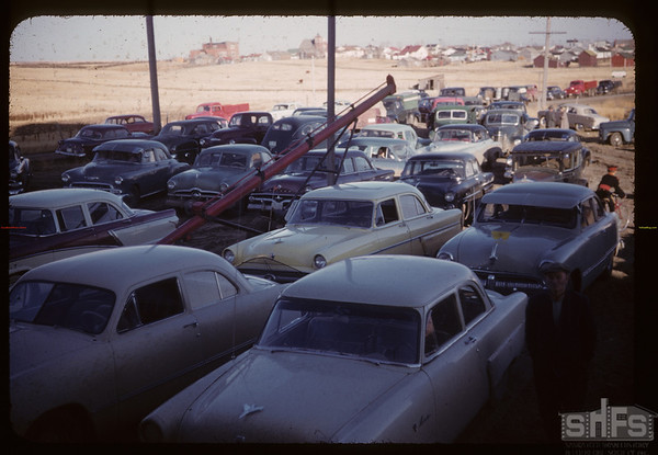 Cars parked for new elevator opening ceremony.   Aneroid, 10/21/1955