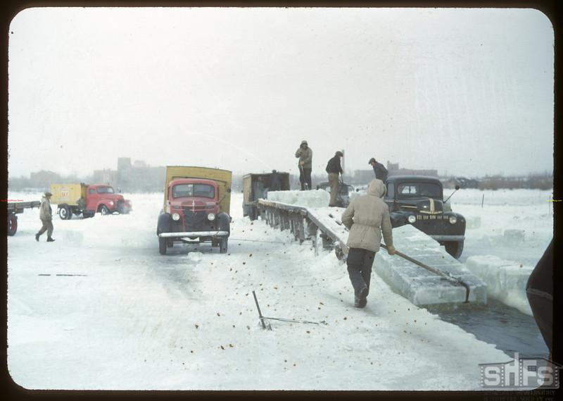 Harvesting ice from Wascana Lake [trucks are Capital Ice - owned by Regina's former  Mayor James Grassick]. Regina 02/21/1948