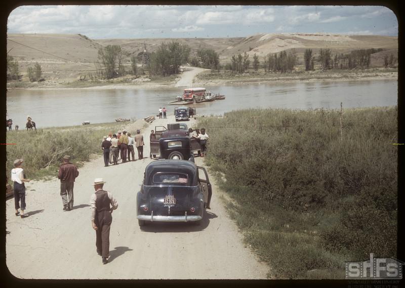 Swift Current Co-op school enroute to Matador Co-op farm. [Ferry operator was Frank Goodwin]. Sask. Landing 07/06/1949